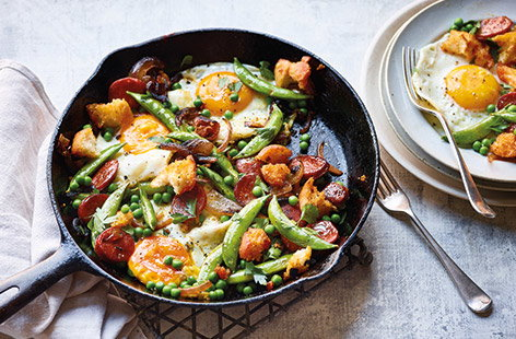 This easy pan-fried chorizo hash is the perfect last-minute meal. Smoky chorizo, crisp chunks of ciabatta and vibrant peas are finished with a fried egg for a quick and easy 20 minute summer recipe that works for brunch, lunch or dinner.