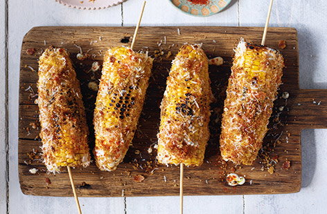 Jamie Oliver's puts a new spin on classic corn on cob with cheese, bacon and paprika for a winning BBQ side.
