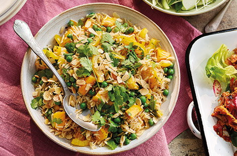 The flavours of coronation chicken have been transformed into a generous rice salad filled with peas, peppers and mango for a delicious colourful side dish – perfect for sharing.