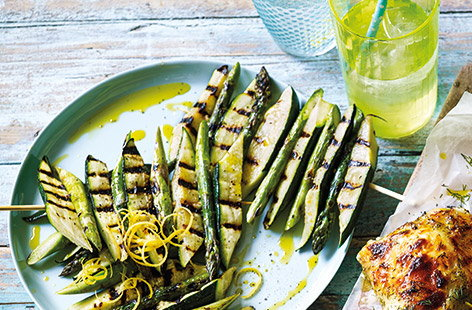 Add some fresh flavours to your barbecue with simple veggie sides. These speedy courgette and asparagus skewers flavoured with olive oil and lemon zest make a fun vegan addition to a barbecue spread.
