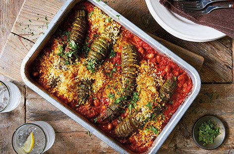 The simple technique of making hasselback courgettes is an easy way to add maximum flavour to your veg. In this one-tray hasselback courgette bake, the courgettes are rubbed with harissa and roasted on a smoky tomato sauce, before being topped with crunchy