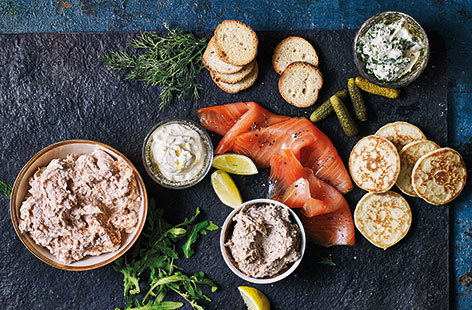 This is the ultimate Christmas party platter – pairing shop-bought blinis and crostini with homemade pâtés and dips is a the ideal way to make a little effort go further