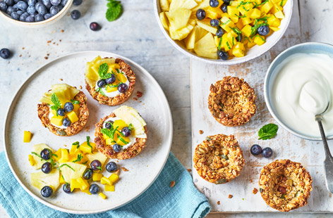 Celebrate Easter weekend with a breakfast treat everyone will love. These cute granola nests act as little crunchy bowls for a yogurt and a tropical fruit salad topping, but you could substitute your own favourite fruits instead, if you like