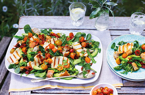Grilled halloumi cheese and crisp, Parmesan croutons make this vibrant salad feel hearty and substantial. Served with a delicious warm tomato and chilli dressing, this salad is packed full of flavour too.