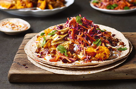 Give roast chicken a North African twist with Jamie Oliver's delicious chicken fajitas, spiced with feisty harissa