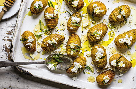 Hasselback potatoes with goat's cheese and honey