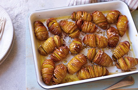 Swap your classic roasties for these simple hasselback potatoes. Baby potatoes are sliced thinly down the middle, drizzled with plenty of garlic butter and roasted until crisp on the outside and perfectly fluffy in the centre – the ideal side dish for your