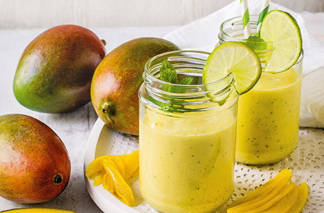 Brighten up your morning with a tropical smoothie, made using the season's best mangoes, zingy lime and warming ginger