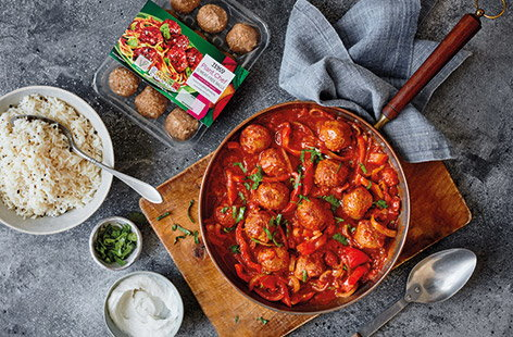 Vegan meatball and tomato spiced curry