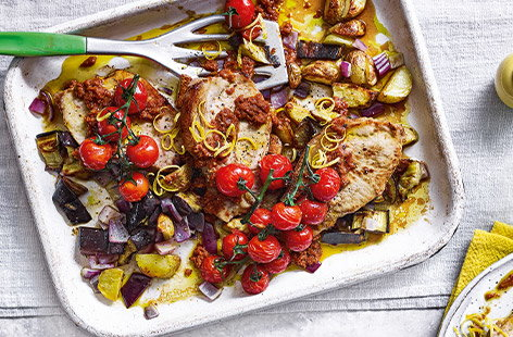 This simple traybake inspired by the flavours of the Mediterranean is sure to be a new favourite with the family. Tender pork steaks are coated in a delicious marinade using sundried tomatoes, lemon zest, fresh chives and Parmesan.