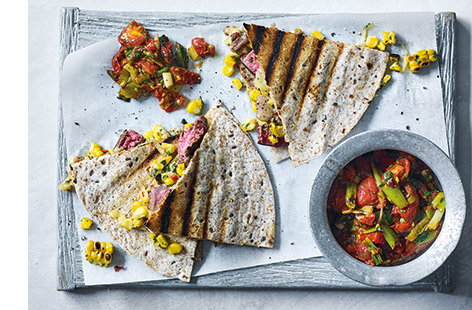 Next time you're cooking steaks on the barbecue, why not try going one step further and using them to fill crisp quesadillas. Juicy slices of steak, charred sweetcorn and a sprinkling of melted cheese make the ultimate BBQ quesadilla filling.