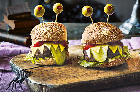 With sharp cheese 'teeth', gherkin 'tongues' and stuffed olive 'eyeballs', these spooky monster burgers are perfect for rustling up for a kids Halloween party