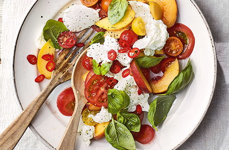 This colourful peach and mozzarella salad is perfect for making when sweet peaches and tomatoes are at their seasonal best, for a fresh summer flavour combination of creamy mozzarella and juicy ripe fruit that really works.