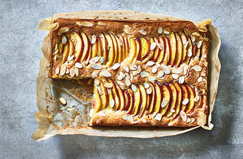 Try this summer twist on a classic Bakewell tart for a pretty dessert that is perfect for packing up and taking on picnics. This easy traybake makes the most of seasonal stone fruit with juicy nectarines topping the soft frangipane and buttery puff pastry