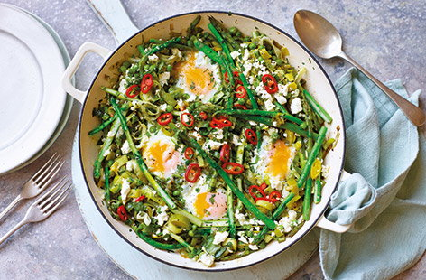 Make the most of fresh spring produce with this green twist on a classic shakshuka. Asparagus, peas and sweet leeks are baked with crumbled feta and eggs for perfect oozing yolks – the ideal veggie brunch recipe or easy one-pot meal.