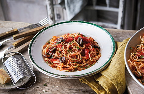 Delve into your store cupboard for a classic Italian pasta puttanesca. This spicy tomato sauce has a kick of chilli heat and is loaded with garlic, capers, anchovies and olives for a super speedy midweek meal, ready in under 30 minutes.