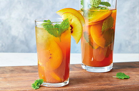 Make the most of summer stone fruit with this fragrant update on a classic iced tea. Fresh peaches are infused with vanilla chai tea for a refreshing treat. Serve over ice with fresh mint for a cool summer spritz.