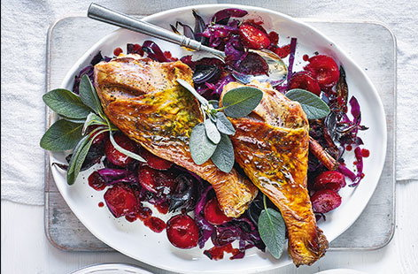 Turkey legs with cabbage and plums