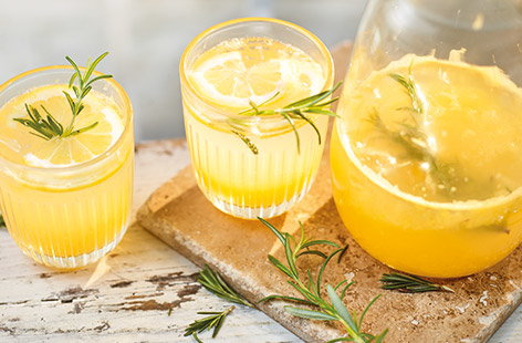 This herbal twist on a homemade lemonade is a sophisticated soft drink to serve all summer.  Fragrant rosemary combines with fresh oranges and lemons for a super refreshing non-alcoholic spritz.