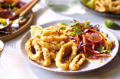 Try our Chinese-inspired twist on classic calamari with this speedy salt and pepper squid recipe. Ready in under half an hour and perfect for entertaining, this quick lunch or dinner combines crispy-coated squid with a fresh veg salad and punchy dressing.