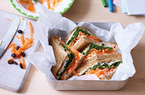 Get the kids to love their packed lunch with this easy healthy sandwich that's packed with layers of fruit and veg. Taking inspiration from a classic carrot cake for the sandwich filling, orange-flavoured soft cheese and juicy raisins add sweetness.