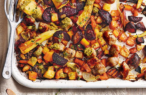 With a rainbow of earthy root veg and succulent pork sausages, this tasty traybake recipe is the perfect winter comfort food