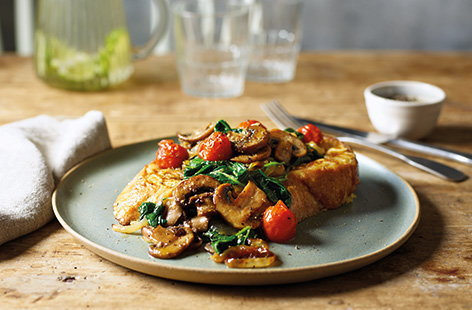 This savoury take on classic French toast is perfect for brunch at the weekend, or equally delicious as an easy midweek dinner. This budget recipe turns stale bread into a quick veggie meal with hearty mushrooms, caramelised onions and roasted tomatoes.