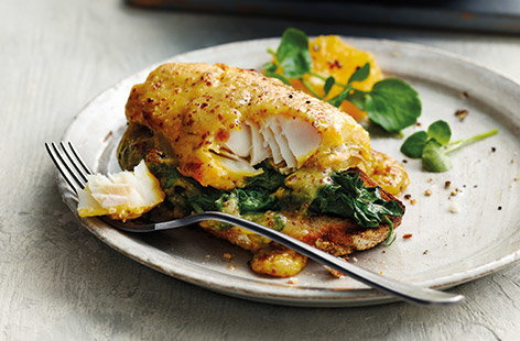 Try a new take on traditional Welsh rarebit with flaky smoked haddock and tender baby spinach