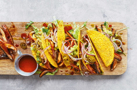 Chef Derek Sarno has created these delicious vegan mushroom tacos, perfect for a Mexican sharing feast. Stuff tacos with onions, mushrooms and jalapenos and top with generous spoonfuls of smashed avocado.