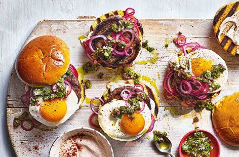 A quick red onion pickle, coriander salsa and a fried egg make this South-American style burger recipe stand out from the crowd. Cook them on the barbecue in summer, or on a griddle pan at any time of year.
