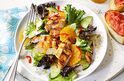 This Spanish-inspired chicken recipe is the perfect summer salad. Classic Spanish tomato bread is an easy accompaniment to the juicy griddled chicken and fresh green salad tossed in a zesty orange dressing for a vibrant midweek meal.