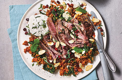 This hearty pilaf recipe swaps rice for bulgur wheat, and simmers slowly in a tangy tomato, garlic and onion stock, giving a wonderfully fluffy base for succulent seared lamb steak