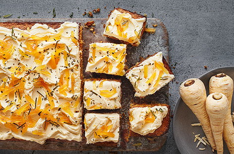 Top this spiced parsnip cake with creamy cheese frosting and fiery ginger for a delicious seasonal bake.