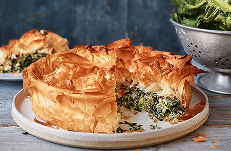 In this seasonal spin on the traditional recipe, try swapping spinach for zesty British-grown spring greens and bake the whole dish into a crunchy, filo-topped pie