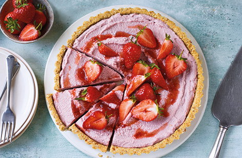 This dairy-free strawberry tart recipe is the perfect vegan dessert for entertaining friends and family. Cashews, oats and dates are blitzed into an easy no-bake tart crust, then topped with a rich coconut and strawberry cream filling.