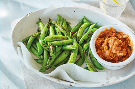 Crunchy, charred and with a hit of zingy chilli and lime, these simple pan-fried sugarsnap peas make a deliciously healthy snack idea – especially when served with a quick, chunky satay dipping sauce.