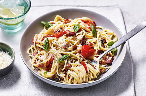 Upgrade classic carbonara with sweet roasted cherry tomatoes – the perfect family dinner idea for celebrating the warmer weather