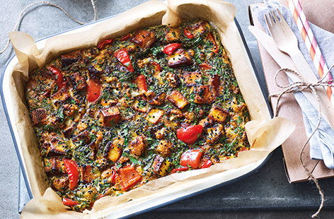 This colourful Indian-inspired traybake recipe is the perfect vegetarian summer lunch. The tandoori-spiced, veg-packed twist on a frittata is filled with sweet red peppers, creamy paneer cheese and plenty of fresh coriander for an easy portable lunch.