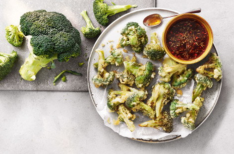Try something different with this Japanese-inspired tempura broccoli recipe. The broccoli is fried in a light, golden batter (sparkling water is the secret ingredient to a super crisp batter) and served with a tangy dipping sauce for a vegetarian starter.