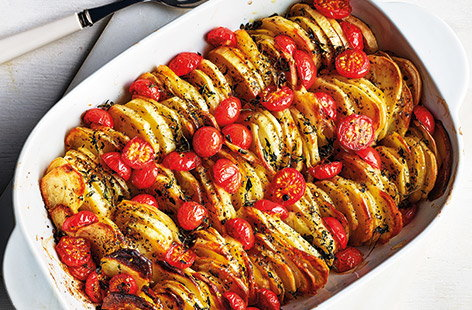 This tasty potato bake with tangy cherry tomatoes and fragrant oregano is the ideal side dish recipe for an Easter feast or Sunday roast