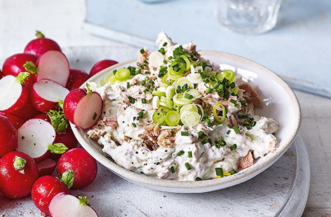 This creamy tuna dip recipe is perfect for summer snacking – simply whip together quark, soft cheese and salad cream, add zesty lemon and spring onions and finish with flaky tuna and chives for a simple dip that's easy to make