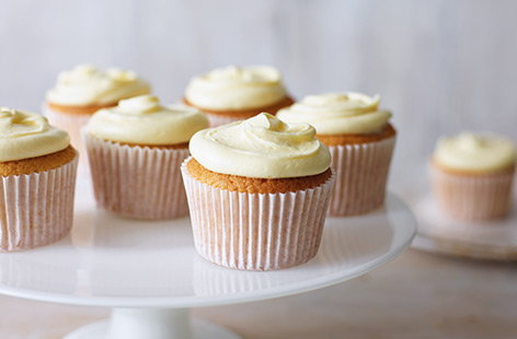 Master a classic baking recipe with these simple vanilla cupcakes. Fluffy, golden sponge is topped with a swirl of rich vanilla buttercream for an easy bake that will be the star of any birthday party, afternoon tea or bake sale.