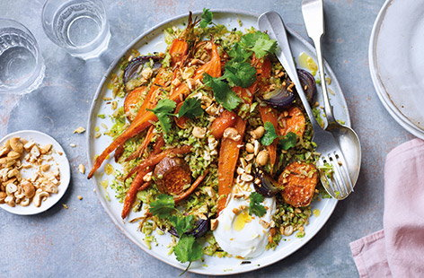 Serve up a colourful veggie supper with this hearty pilaf, packed with carrots, sweet potato, red onions and broccoli. The root veg is roasted in spices, then tossed with nutty wild rice and grated broccoli for a healthy vegetarian feast.