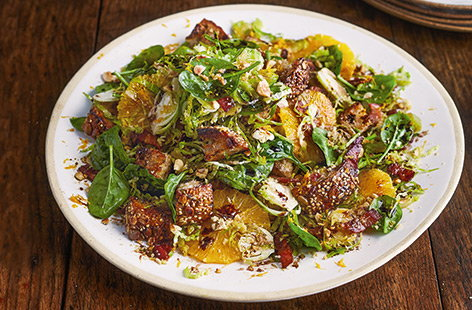 Make the most of sprouts in this seasonal salad that's tossed together with bacon, spinach, orange and hazelnuts