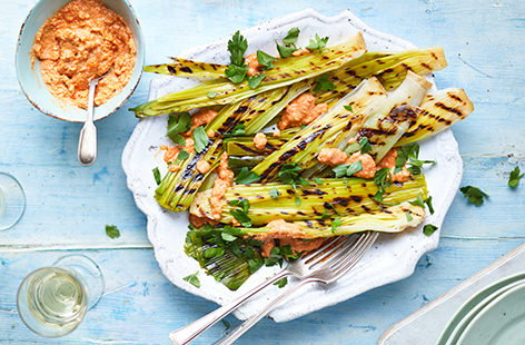 Charred leeks with romesco sauce