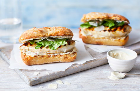 This chicken Caesar salad-inspired burger gets its swagger from a creamy, Parmesan-laced mayonnaise. Rather than fiddling around with mince, we simply pound chicken breasts to resemble burger patties, and then pan fry.