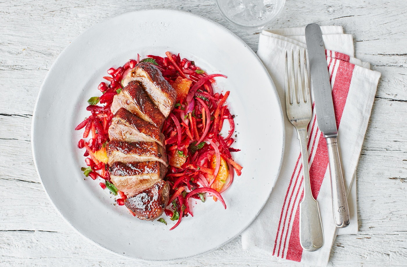 Spiced duck breasts with beetroot, orange and pomegranate slaw recipe