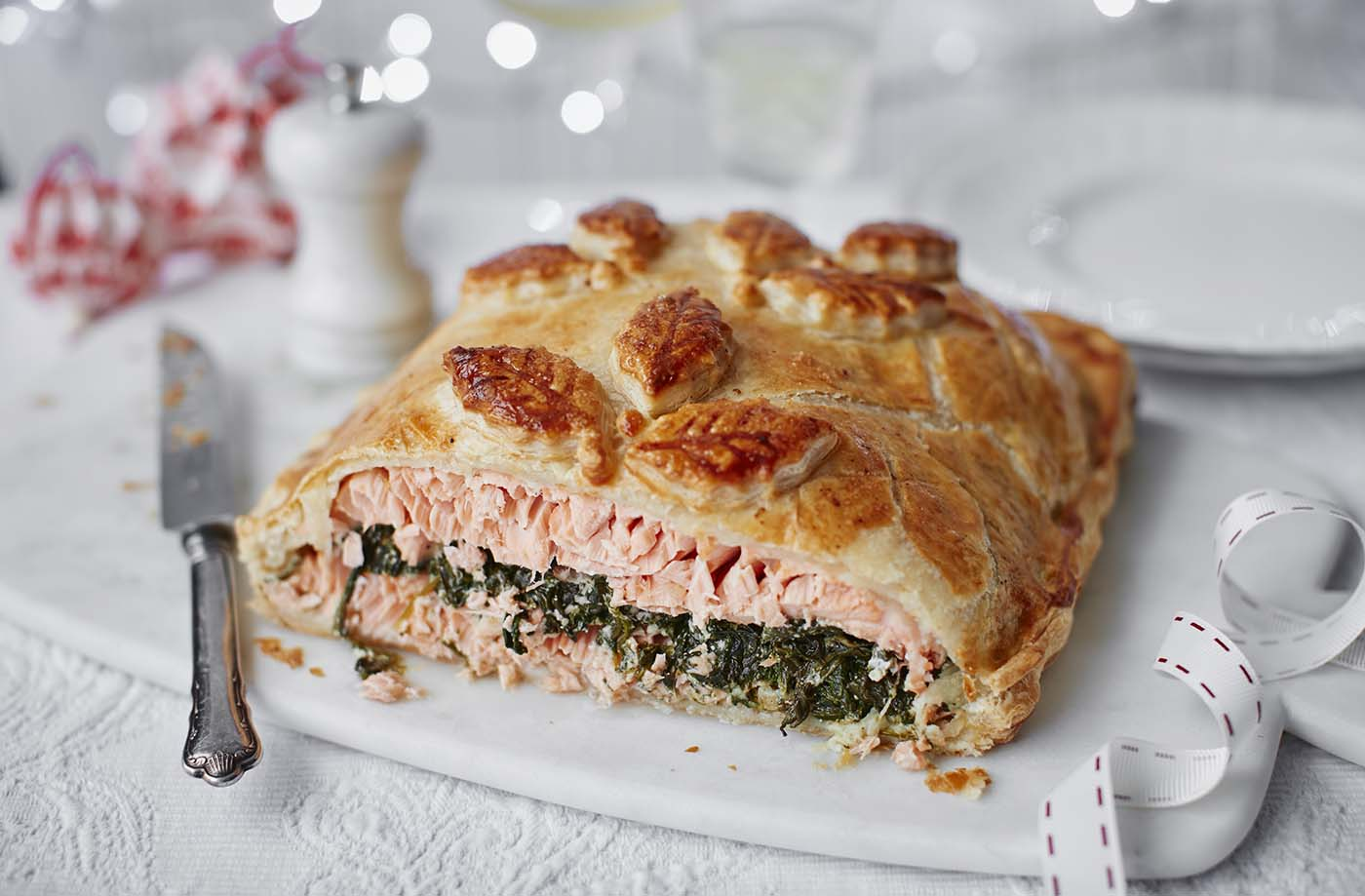 Salmon en croute with spinach and almonds