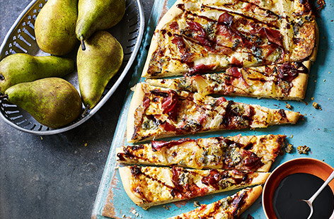 Using sweet pears as a pizza topping, alongside punchy Gorgonzola cheese, crème fraîche and a balsamic glaze, is a brilliant way to make the most of the season's juiceiest harvest