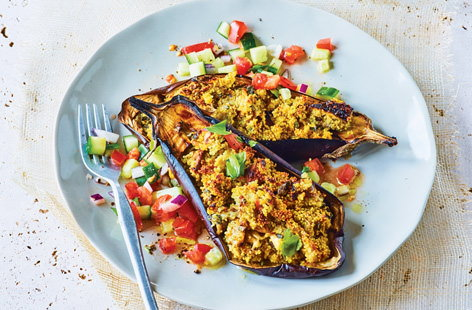 Savour the spices of Morocco with this succulent stuffed aubergine recipe. Filled with a spiced cous cous and served with a fresh cucumber and tomato salsa salad, this makes an easy vegetarian and dairy-free midweek meal.